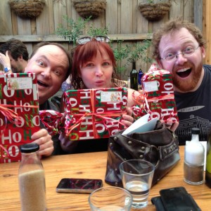 "David Ashton, Petra Elliott and Ben McKenzie with presents from ""Santa Capaldi"" on Christmas Eve."